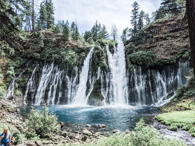 Multiple waterfalls cascading into a pool